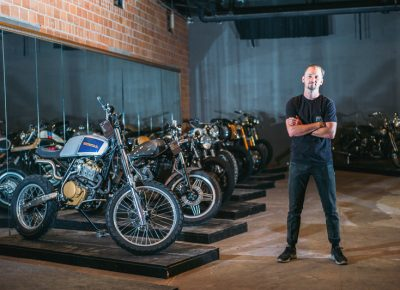 "Salty Bike Revival co-founder Jason ""Rev"" Clark poses next to a row of bikes in the invited builder room. Photo: @clancycoop"