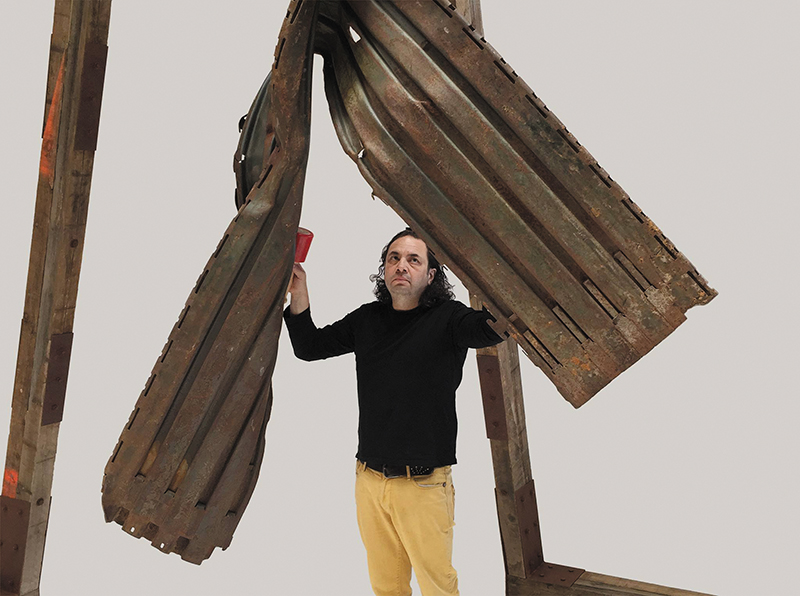 "Guillermo Galindo with Ángel Exterminador | Exterminating Angel, a musical instrument he forged from the ""old wall"" between the U.S. and Mexico."