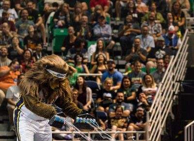 The Jazz Bear absolutely blasts a single fan with silly string during the Salt Lake Comic Con panels at the Vivint Smart Home Arena. Photo: @Lmsorenson