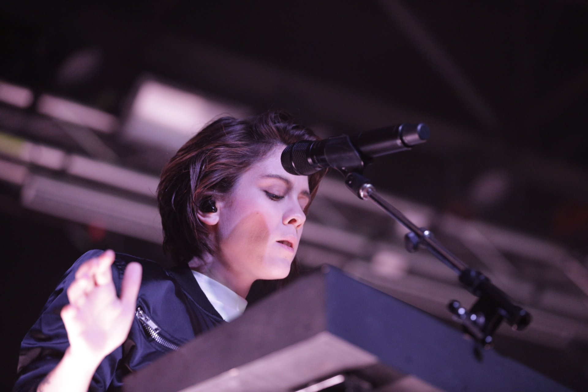 Tegan of Tegan and Sara playing keyboards onstage in Salt Lake City. Photo: @Lmsorenson