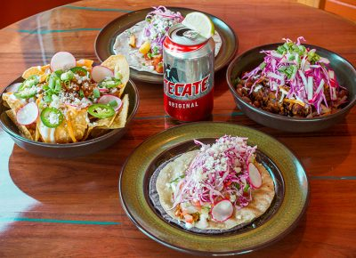 The bright colors and bold flavors of Blue Poblano's Dang Quesadilla and Vegetarian Taco pair perfectly with a refreshing, ice-cold Tecate.