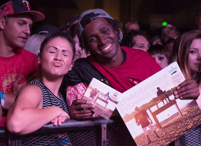 Brooke and Nate show off their merch as they wait to see Atmosphere. Photo: ColtonMarsalaPhotography.com