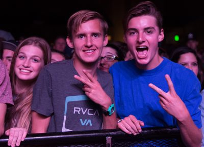 Samantha, Chandler and Josh hold down a front row spot for Atmosphere. Photo: ColtonMarsalaPhotography.com