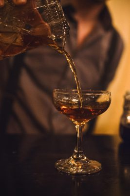 That burnt red work of art being poured over a cherry in a martini glass is what has lead me on a vigorous search for black walnut bitters over the last year. Photo: Talyn Sherer