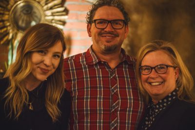(L–R) Erica New snags a photo with Sara Lund's parents, Mike and Cheryl Burns. Photo: Talyn Sherer