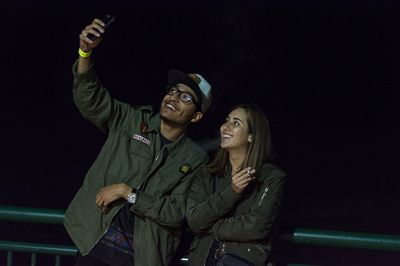 Two fans share a smoke and a selfie in between sets. Photo: ColtonMarsalaPhotography.com