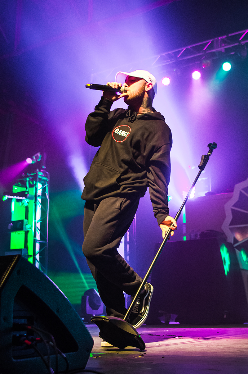"""Bathed in purple light, Mac Miller grooves on stage."" Photo: ColtonMarsalaPhotography.com"