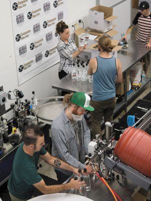 On bottling days, the Ogden's Own team prepares the distillery's standout products for the liquor-store shelves, including their latest, the Porter's Peach Liqueur.