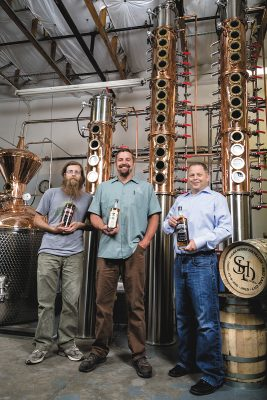 (L-R) Assistant Distiller Richard Malyn, Head Distiller Eric Robinson and Owner James Fowler create genuine craft spirits from start to finish at Sugar House Distillery.