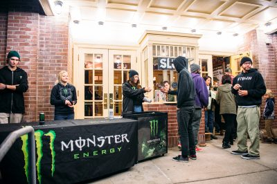 A patron receives a free energy drink, courtesy of Roughside's presenting sponsor, Monster Energy. Photo: Niels Jensen