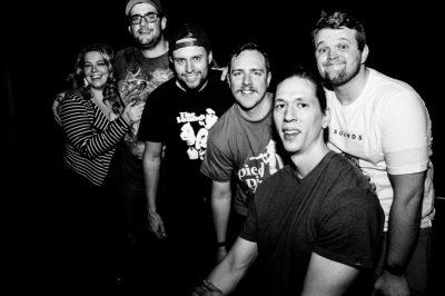 (L–R) Nadia, Scott, Austin, Erick, Robert and Jordan pose for a quick picture after The Sounds' set. Photo: Gilbert Cisneros