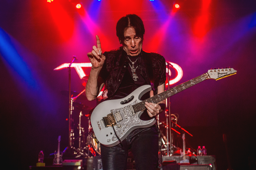 Steve Vai asks for a moment from the crowd as he prepares to unleash a guitar solo that melted the faces of at least three people in the front row. Photo: Talyn Sherer