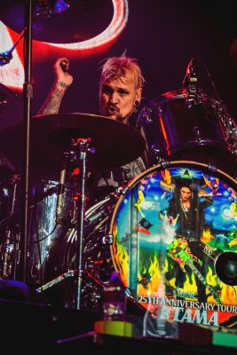 Jeremy Colson brought out the big guns as he wrecked up the acoustic drums while performing with Steve Vai. Photo: Talyn Sherer