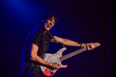 Steve Vai bows to the crowd and his guitar. Photo: Talyn Sherer