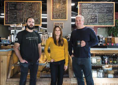 (L–R) Head Roaster Zach Amador, President Stacey Maxwell and CFO Steve Brewster underscore the freshness of their roasts at Millcreek Coffee.