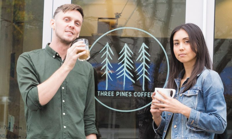 (L–R) Nick Price and Meg Frampton brew coffee and espresso with adroit attention to each scientific detail at Three Pines Coffee.