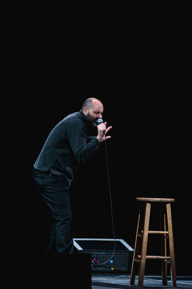 Ted Alexandro, mimicking the playing of a violin. Photo: Lmsorenson.net