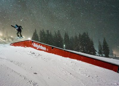 Local Salt Lake snowboarder Jonah Car Michael hit the boxes at the well-lit terrain park, accessible by the Majestic Lift. Photo: Jo Savage // @SavageDangerWolf