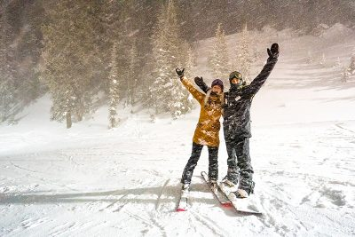 Stoked-out riders Fern and Pat cheered as they stood in the snow and amped for their next fun-run. Photo: Jo Savage // @SavageDangerWolf