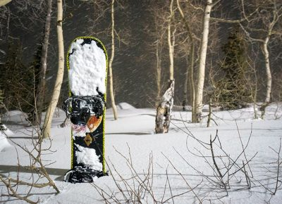 The snowboard waited patiently in soft, deep and fluffy pow while its rider photographed the terrain park. Photo: Jo Savage // @SavageDangerWolf