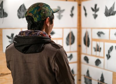This attendee checked out the leaf art done by Alexis Hansen. Photo: Jo Savage // @SavageDangerWolf