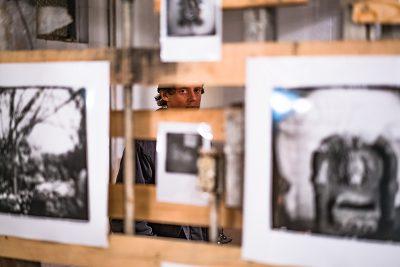 John Blume interacted with James Dumas' photography exhibit. Entropic Dreams. Photo: Jo Savage // @SavageDangerWolf