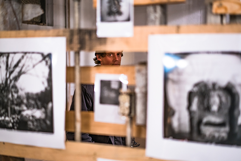 John Blume interacted with James Dumas' photography exhibit. Entropic Dreams. Photo: Jo Savage // @SavageDangerWolf