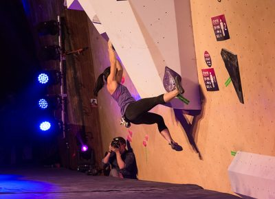 Nina Williams holds a strong toe hook on the first problem. Photo: ColtonMarsalaPhotography.com