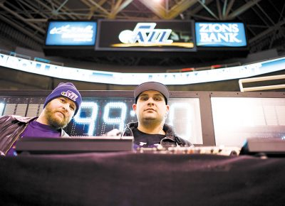 (L–R) Mike Brown watches DJ Juggy work his magic as the Utah Jazz's in-house DJ. Photo: @clancycoop