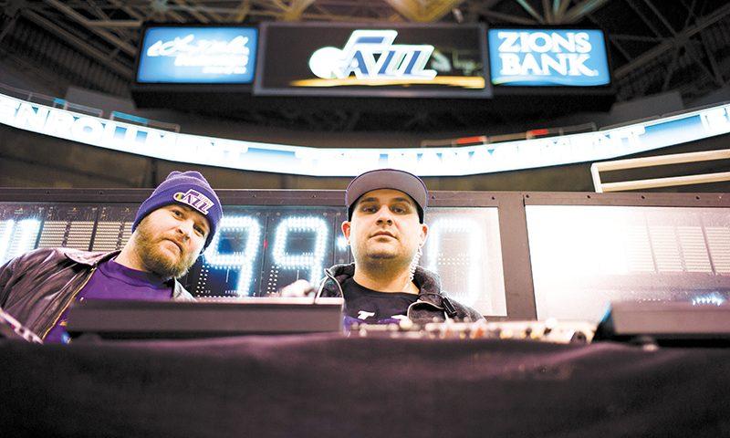 (L–R) Mike Brown watches DJ Juggy work his magic as the Utah Jazz's in-house DJ. Photo: @clancycoop