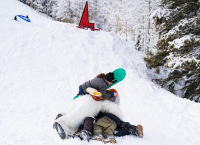 People dog piled Makalu Arnold after he was announced the winner of the Men's Open Snow. Yeti got in on it too. Photo: Jo Savage // @SavageDangerWolf