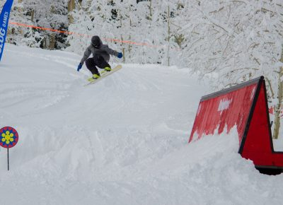 Spencer Dallas 2nd place 17 & under mens snow Flying off the jump. Photo CJ Anderson