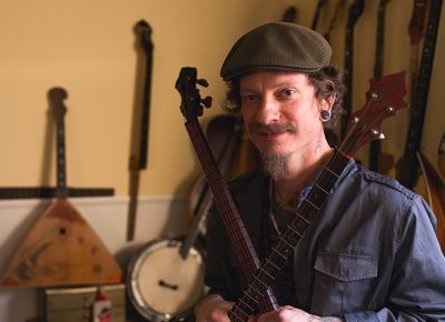 Wallace Mecham creates banjos hybridized with Eastern stringed instruments. Photo: LmSorensen.net