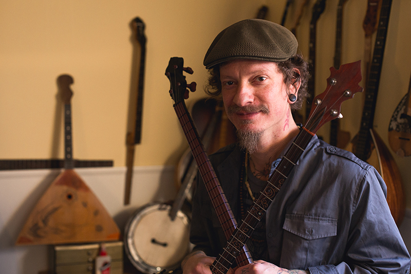Wallace Mecham creates banjos hybridized with Eastern stringed instruments.