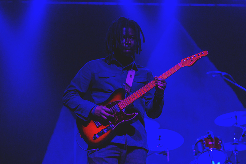 Lewis Del Mar's touring guitarist gets lost in the pale blue lights on stage. Photo: Talyn Sherer