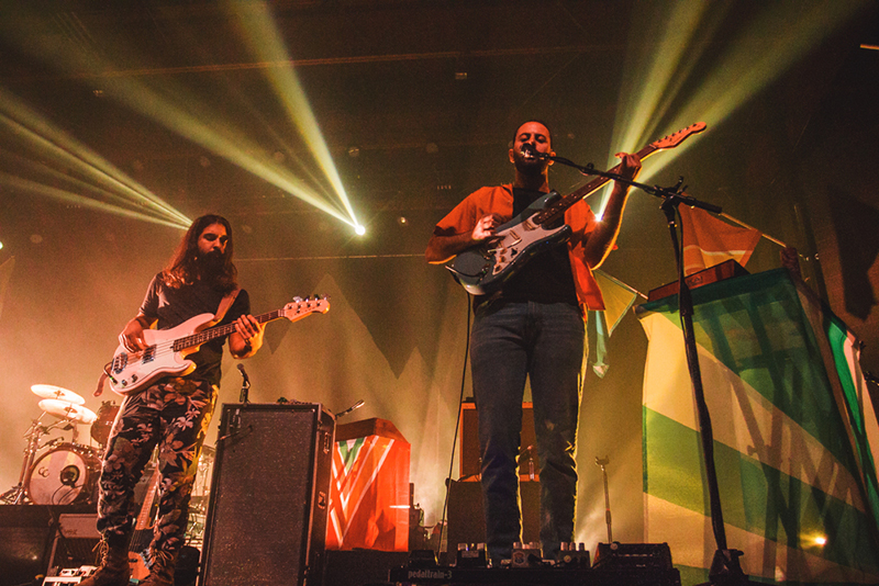 (L-R) Payam Doostzadeh and Eric Cannata of Young the Giant perform under golden lights at the The Complex SLC. Photo: Talyn Sherer.