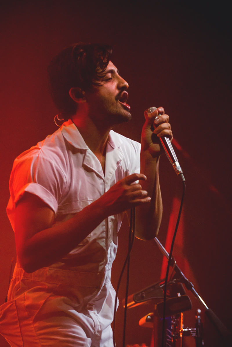 Sporting the white jumpsuit and thin-lines mustache, Sameer Gadhia of Young the Giant is both a fashion icon and musical legend. Photo: Talyn Sherer.