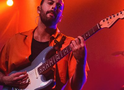 Eric Cannata of Young the Giant sports the blue Fender guitar that is a staple in the music industry. Photo: Talyn Sherer.