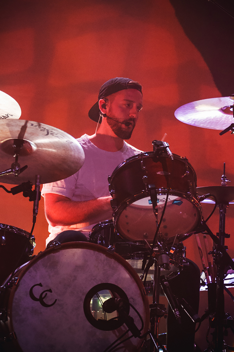 Young the Giant drummer, François Comtois, cranks out the edgy tones from center stage. Photo: Talyn Sherer.