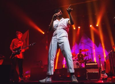 Sameer Gadhia looks off in a brief moment of curiosity while performing with his band Young the Giant. Photo: Talyn Sherer.