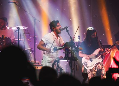 Young the Giant's Sameer Gadhia moves to his own personal rig of noise, complete with a cowbell and all. Photo: Talyn Sherer.