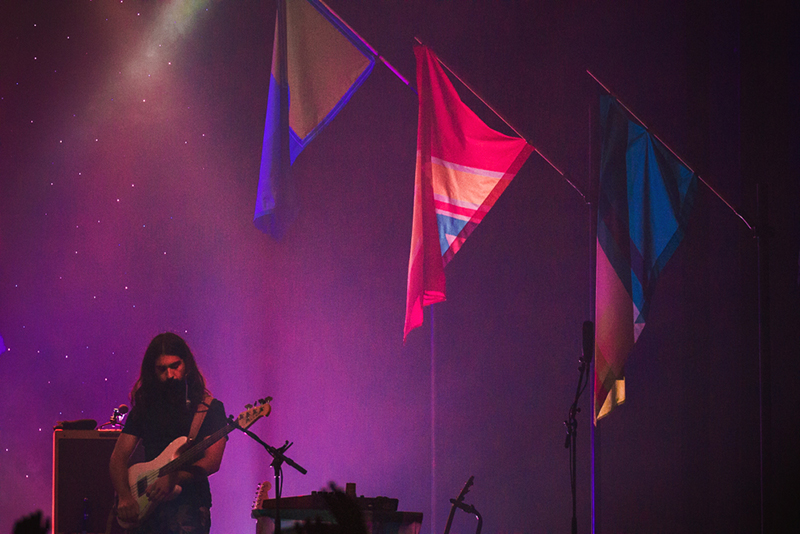Payam Doostzadeh of Young the Giant plays out the bassy notes under the band's signature flags from their latest album. Photo: Talyn Sherer.