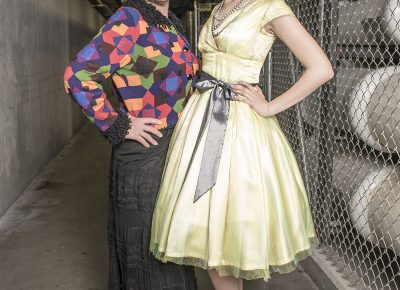 (L–R) Designer Betsy Barker and model MeKall Ryan of Betsy Couture Vintage Wedding Gowns.