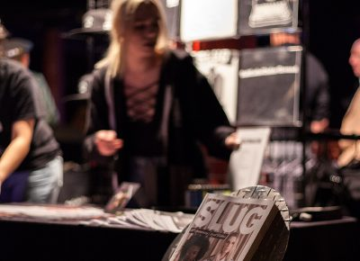 The badass SLUG Mag booth selling merch. Photo: CJ Anderson