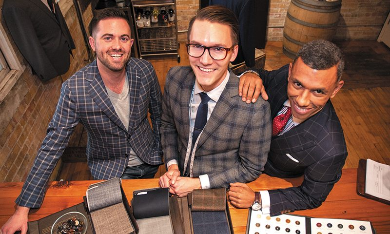 (L–R) Tailor Cooperative Co-founders Chase Murdock and Adam Malmborg and Personal Tailor Eduardo Xavier offer from-scratch suit tailoring to achieve the perfect fit.