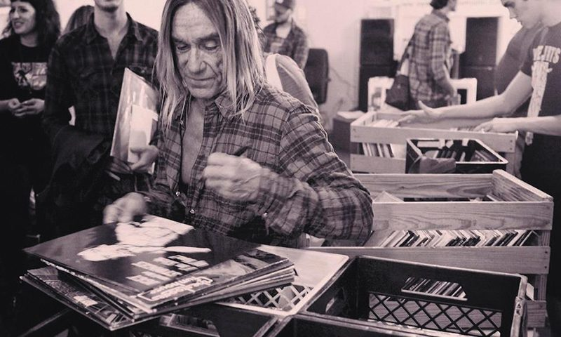 Promotions like Iggy Pop signing records at Miami's Sweat Records in 2012 have helped Record Store Day nourish the record industry.
