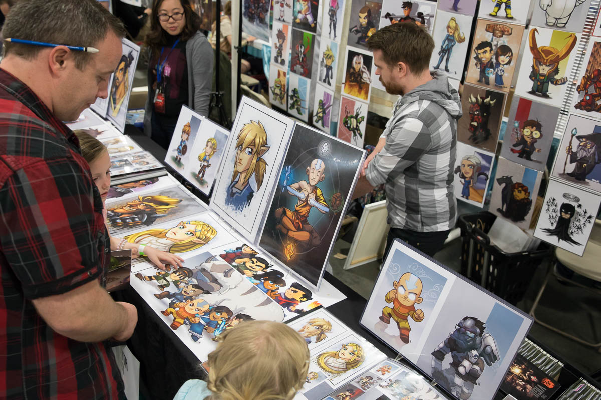 Artist Steven Crowe sells a print to a very small fan of his work. Photo: Lmsorenson.net