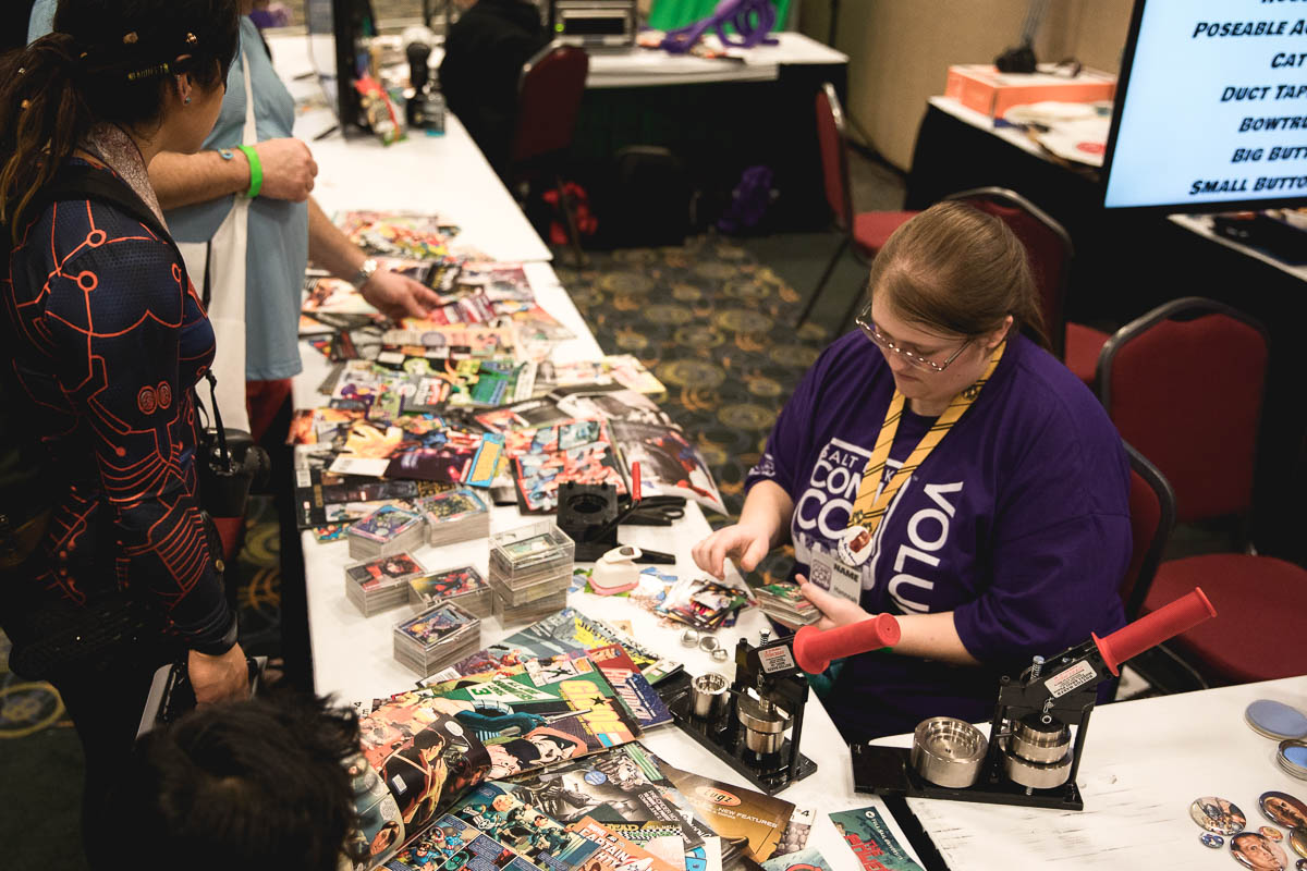 Kid Con! Small cosplayers are able to make their own buttons out of old comic books and other materials. Photo: Lmsorenson.net