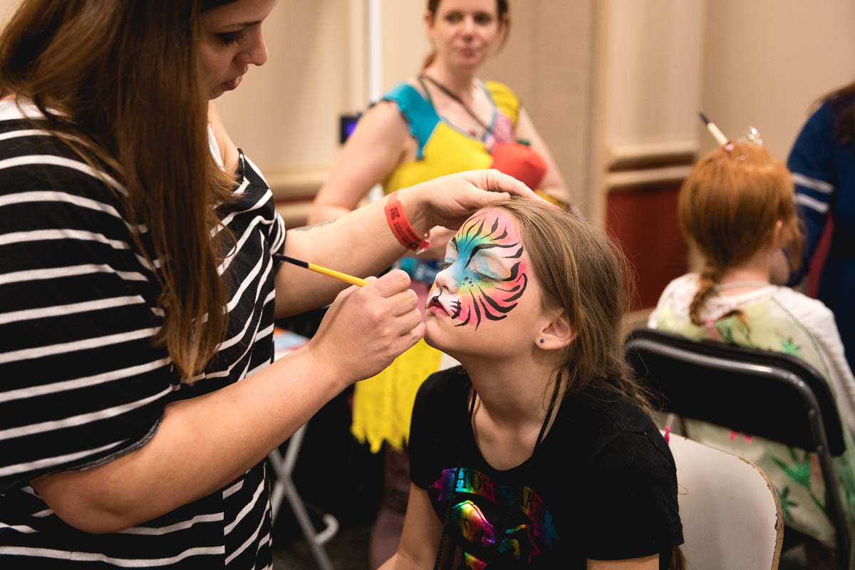 Con attendee Zoey and her mother Jennifer (not pictured) enjoy the face painting at Kid Con inside FanX17. Photo: Lmsorenson.net