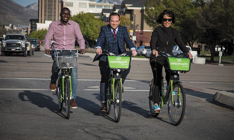 (L–R) GREENbike annual pass holder Fred Makobongo, GREENbike Founder and Director Ben Bolte and annual pass holder Valerie Kitchen find convenience in GREENbike's Downtown SLC presence. Photo: John Barkiple